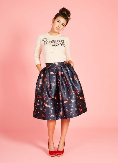 navy cocktail print skirt and pink jumper with prosecco embroidery and sequins