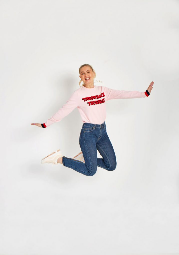 Gabrielle jumping for joy in the Jeudi jumper